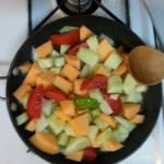 Honeydew Melon, Cantaloupe, Tomatoes, and Basil sauteing in Olive Oil.