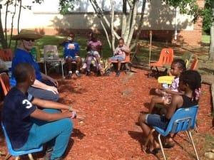 Young readers enjoy the garden.