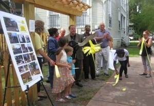 Neighborhood President Maurice Norman cuts the ribbon when the garden was new.  Also pictured is Savannah mayor Edna B. Jackson.